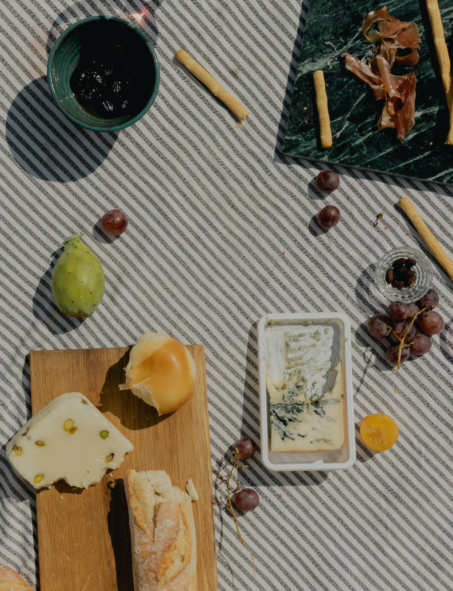 Wine, cheese, salumi baguette picnic pantry staples