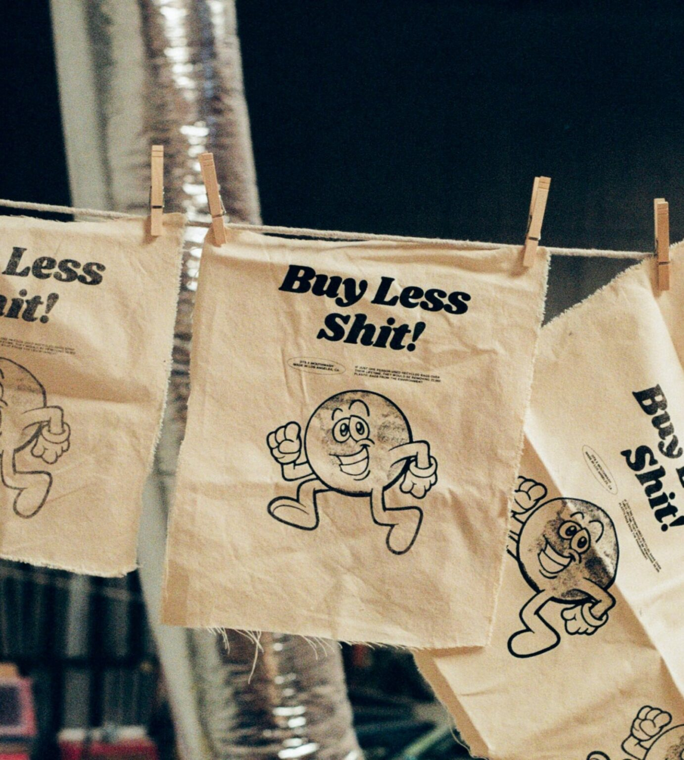 Buy less shit flag conscious consumerism