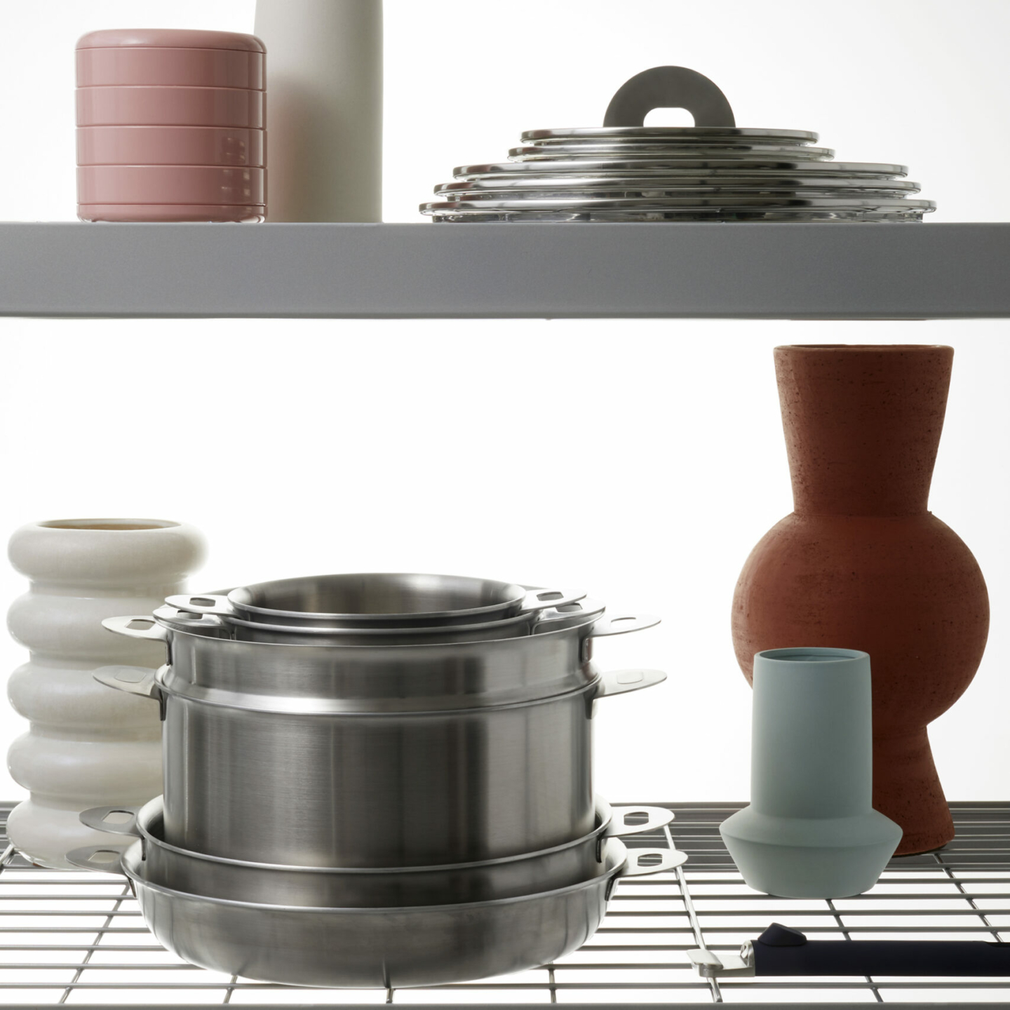 ENSEMBL Stackware lids and cookware in cupboard