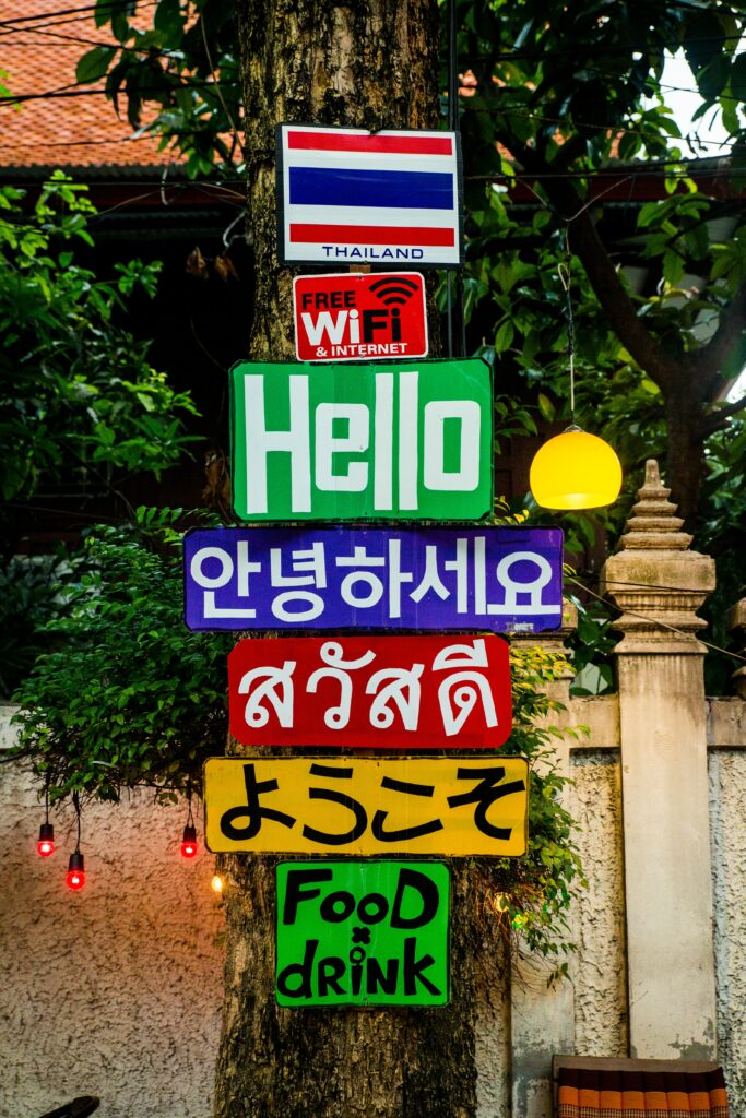 Thailand sign in multiple languages food and drinks colourful
