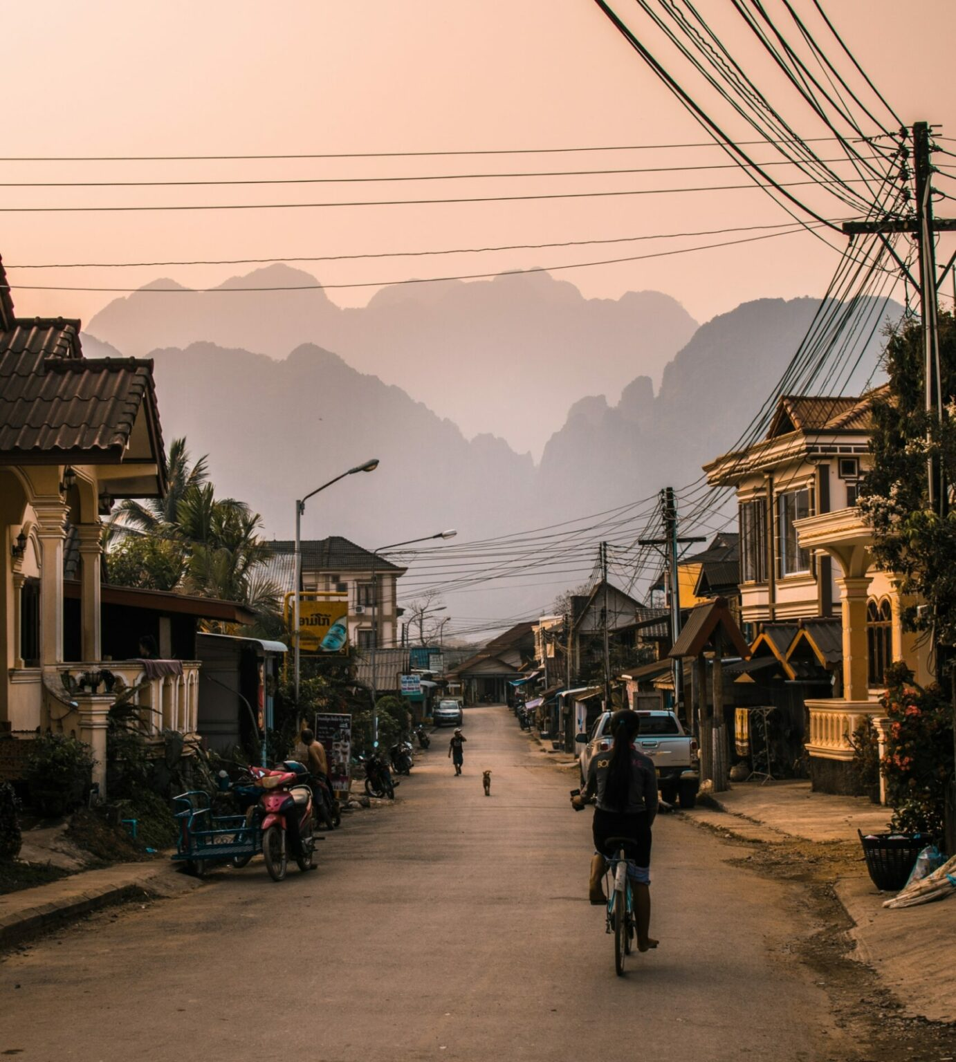 Vang Vieng, Laos street with bike and mountains