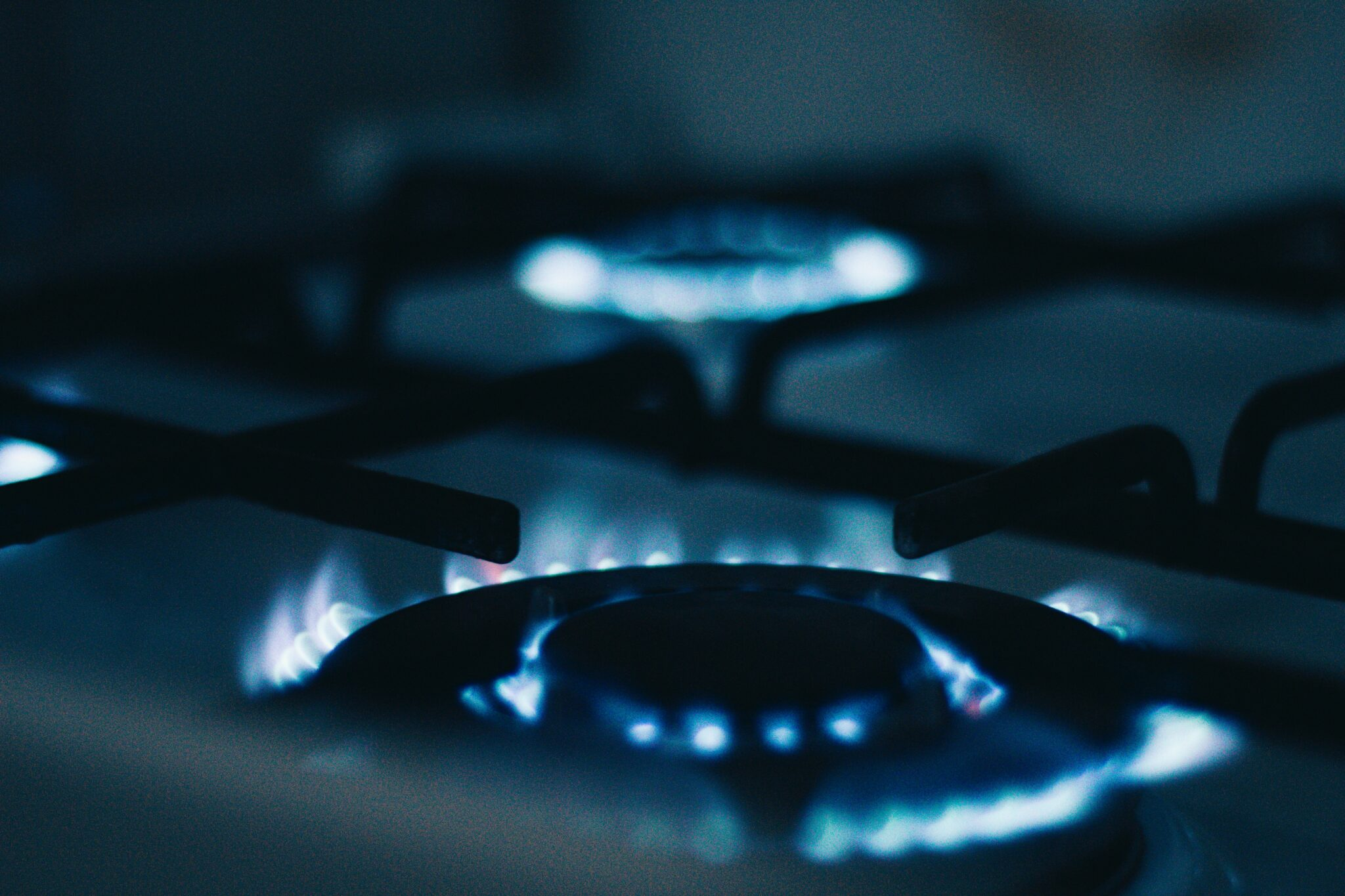 Stainless steel cookware on gas flame element