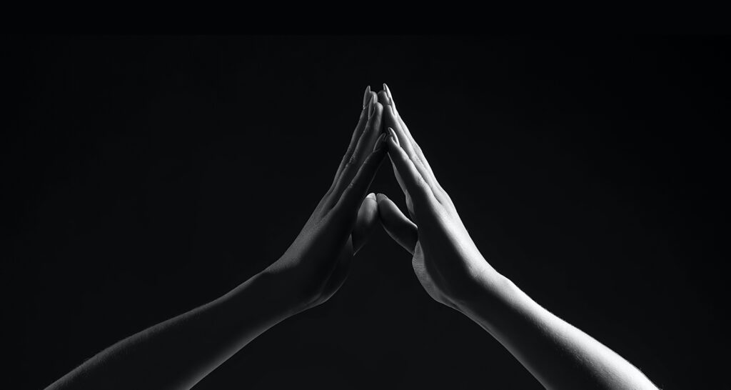 International Women's Day two hands touching black and white