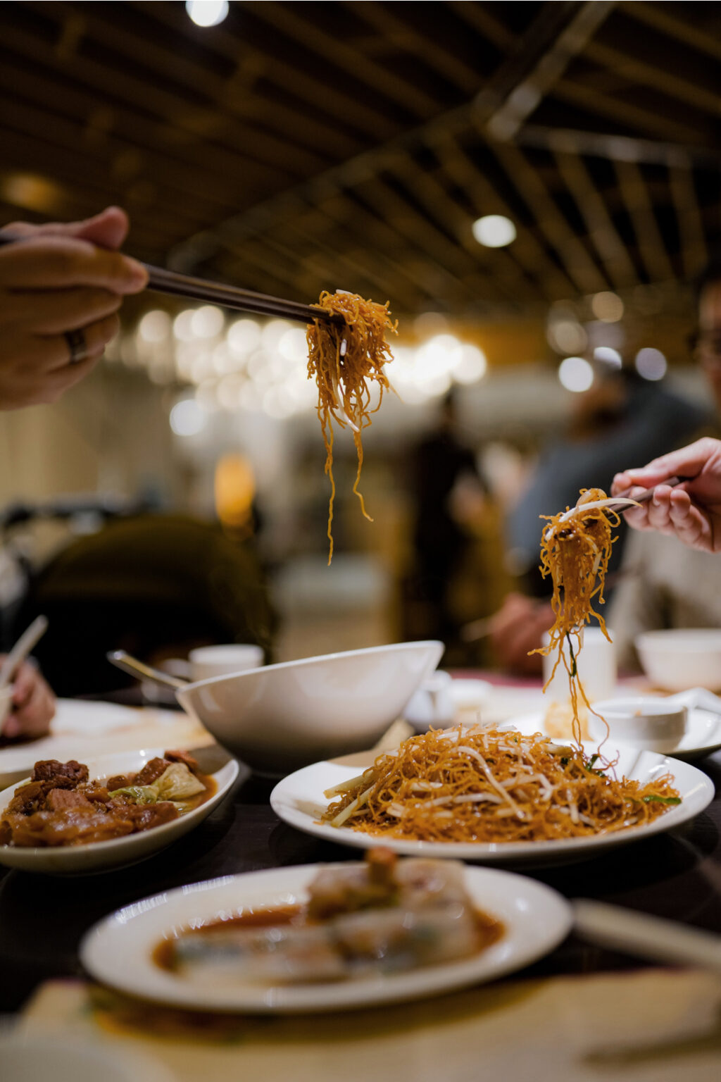 Sharing Chinese Noodles at the table