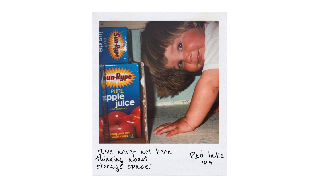 Girl in cupboard with apple juice