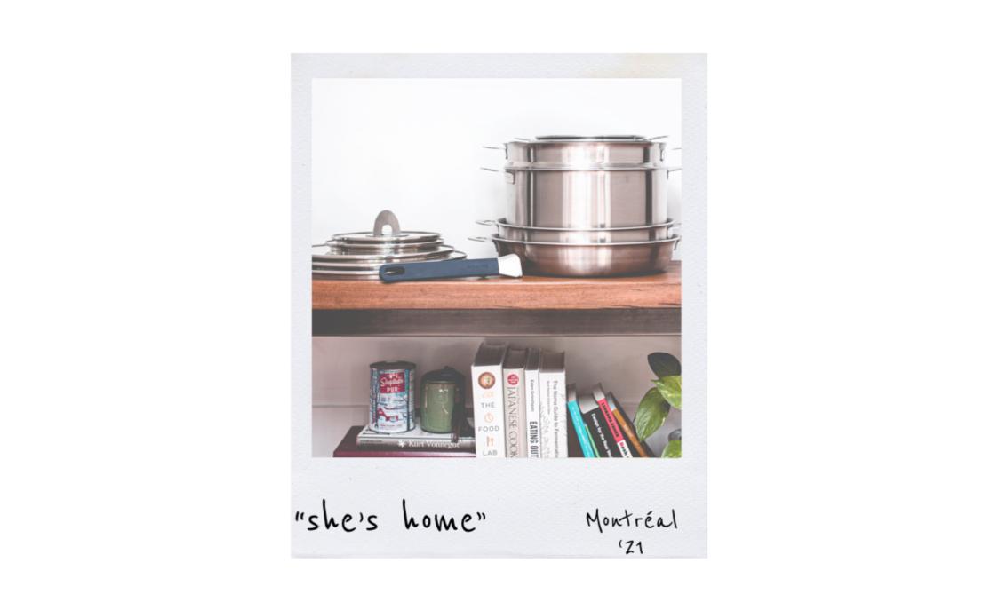 Stackware on shelf above cookbooks