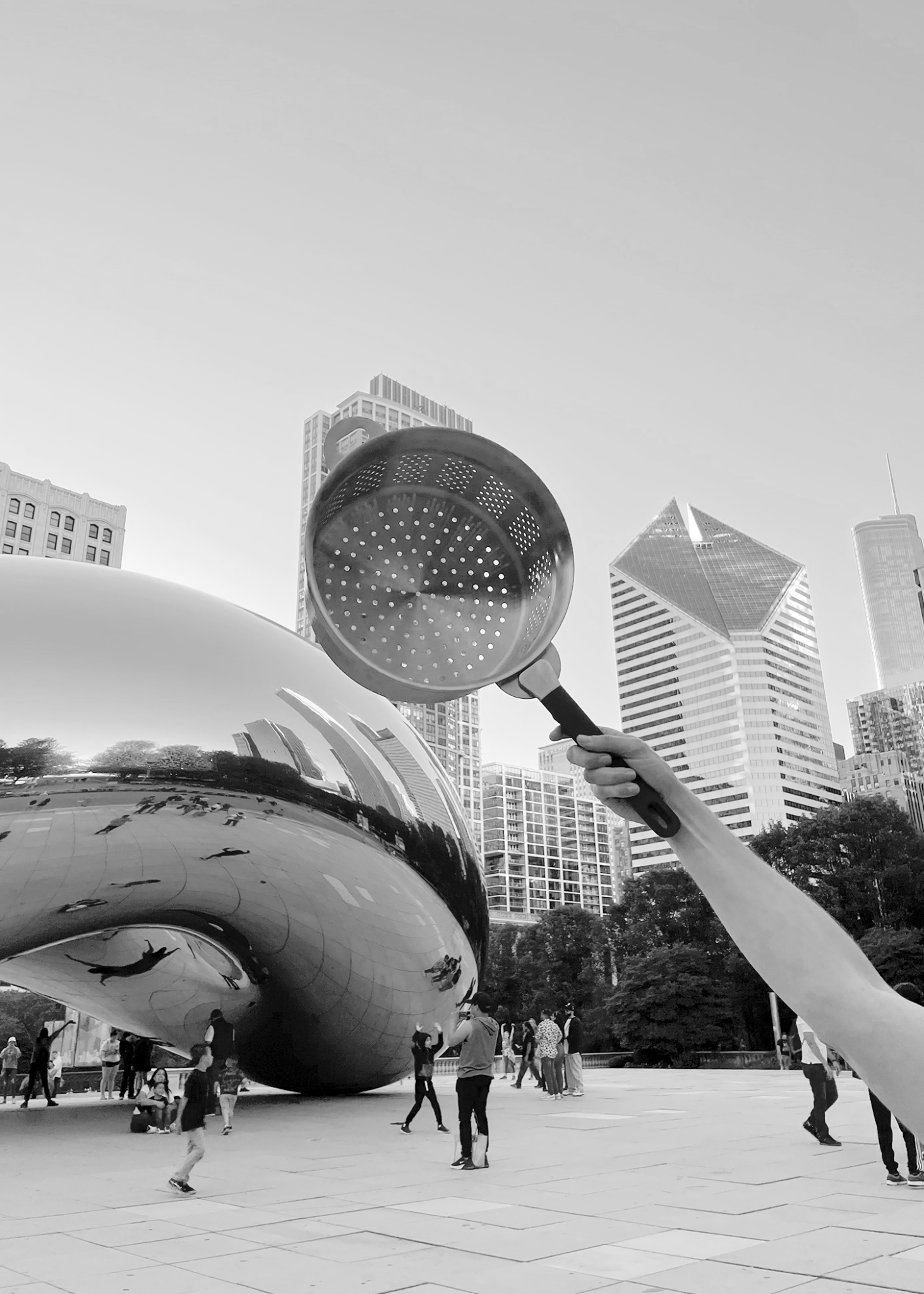 Hand holding Stackware Steamer in front of Chicago bean cloud gate statue