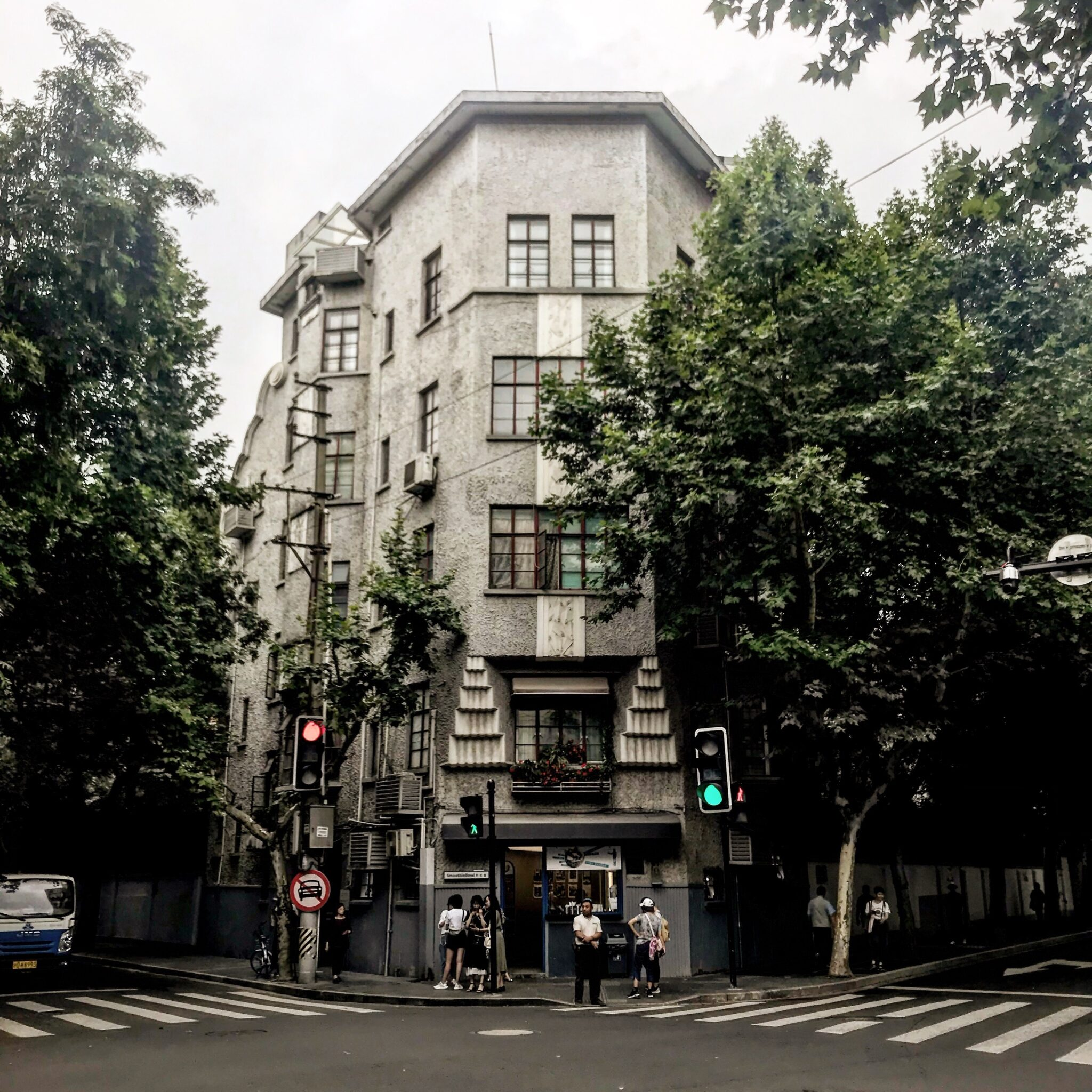 tall grey building with crosswalk