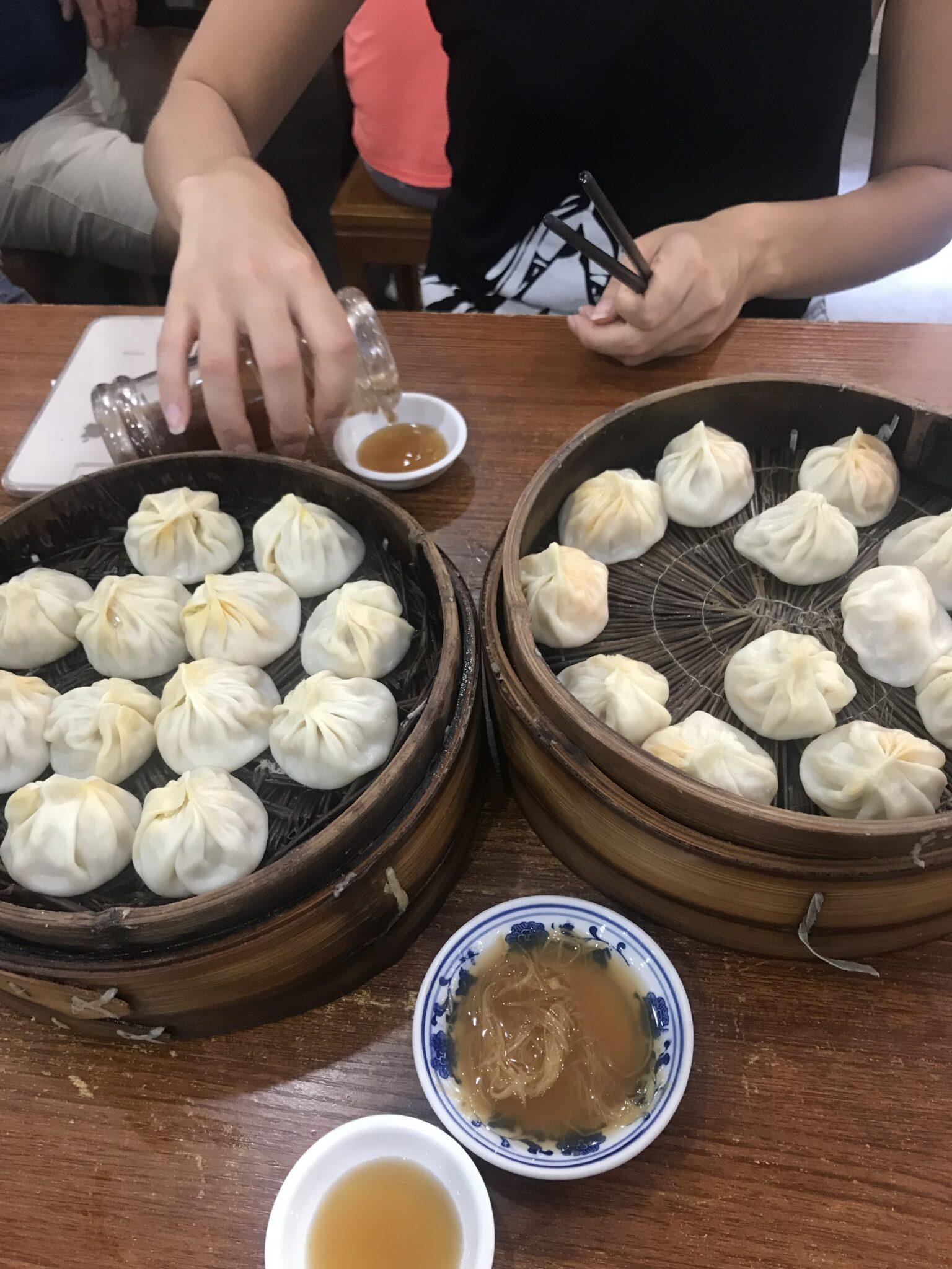 Xia long bao soup dumplings on wood table