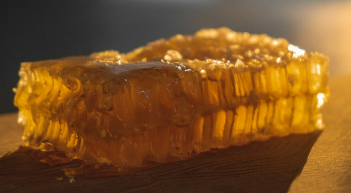 Golden honeycomb on table
