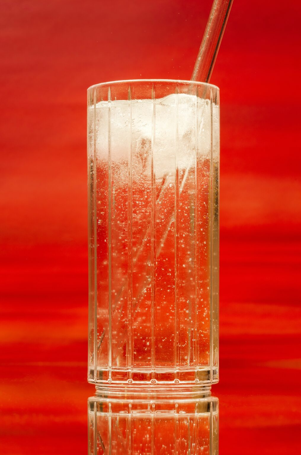 Iced drink on red background